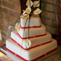 Four Tier Stacked Wedding Cake Four tier, offset stacked wedding cake, each layer a different flavour, calla lily spray topper
