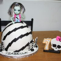 Frankie Stein This was a birthday cake for my daughter. The dress is based off the Frankie Stein Dawn of the Dance doll. The skull is make of a fondant/...