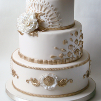 Ivory And Gold Wedding Cake Elegant ivory and gold wedding cake.
