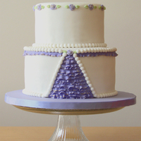 Elegant Ruffle Cake In White And Violet