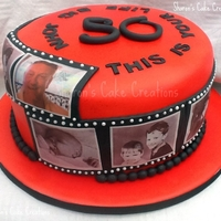 Red This Is Your Life Timeline Cake with edible photo's