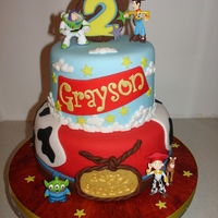 Toy Story Themed Fondant Cake (Dec 2014) I Love this cake. :D Made everything from Fondant/Gumpaste. The figures are toys. Hope you like it!! xMCx