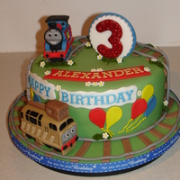 Thomas The Tank Engine Fondant Cake (Jan 2015) Made everything from Fondant/Gumpaste. This is my first attempt at making a Fondant Thomas Train and Diesel :D Hope you like it...