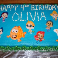 Bubble Guppies I made this for my daughter's 4th birthday. This is a 1/2 sheet of homemade choc. cake with homemade BC. The characters are made out...