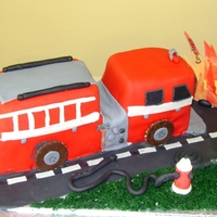 Fire Truck This was a cake for my niece it was her birthday and a congratulations on finishing the Fire Fighter course two weeks earlier.I'm...