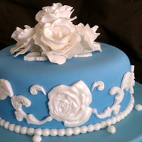 Blue & White Pearl Cake Mmf covered cake with mmf scrolled spirals , sugar paste flowers w realized paint air brushed. My final cake for class.