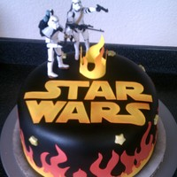 Star Wars Birthday Cake This cake was for a 6 year olds birthday cake that wanted flames and starwars. Flames and starwars logo made from frosting sheets, cut by...