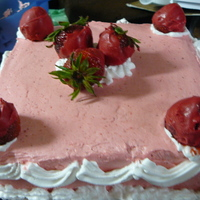 Strawberry Cake Strawberry butter cream frosting with choco covered strawberrys on top