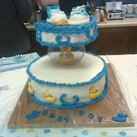 Its A Boy butter cream frosting with choclet mold gum paste shoes