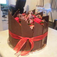 Choc Panels And Choc Dipped Strawberries On Top Of A 3 Layer Blackforest Gateau Cake.