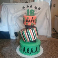 Boy's 16Th Birthday Beatles Cake Bottom and middle tier is buttercream with fondant accents. Top tier is fake cake dummy covered in fondant. Seperators are foam covered in...