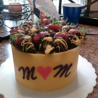 "Mom Chocolate wrapped cake with chocolate dipped strawberries. ""MOM"" is chocolate also.It was soooo good!!"