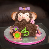 Buttons & Bows Monkey Client requested a monkey cake incorporating the color purple for her daughter's 3rd birthday, with suggestions for the overall design...