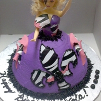 Lady Gaga Doll Cake Requested by client to do Lady Gaga doll cake for her 4 year old's birthday. Favorite colors were used and cake is strawberry with...