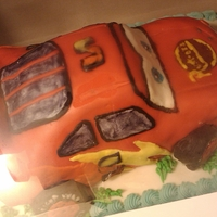 1St Rkt Cars Cake  This is a lightening mcqueen cake I attempted, the car is rkt. I think it looks pretty good for my first attempt. I decided to take pics...
