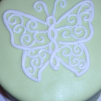 Filigree Butterfly 6 inch cake covered in MMF. Butterfly design also MMF.