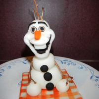 Olaf Cake Topper Made of MMF with grape stems for hair and arms.
