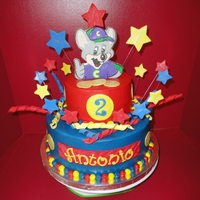 Chuck E Cheese Double fudge cake, fudge filling, iced in buttercream and fondant decorations. Chuck E was made with fondant/gumpaste.