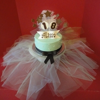 Alissa's Ballerina Cake WASC with strawberry filling, iced in buttercream, fondant decorations. The ribbon/bow is the only thing not edible