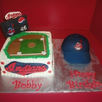 Happy Birthday Bobby! Strawberry cake: Field is iced in buttercream with fondant accents and hat is strawberry cake also, covered in fondant.