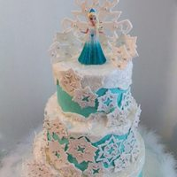 Disney's Frozen Cake iced in buttercream, snowflakes and topper made with gumpaste/fondant mix. *