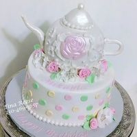 Teapot Cake Teapot made out of rkt and covered in fondant. Ribbon roses and fantasy flowers out of gumpaste.