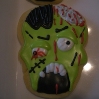 Zombie Cookie Frankenstein cutter becomes a Zombie using Glaze Icing.