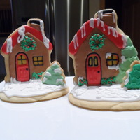 Christmas Cottage Cottage cookie cutter decorated for Christmas. Used extra icing to stand the house up on cookie base. Sugar Cookie with Glaze Icing