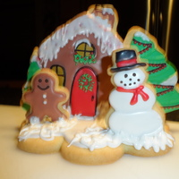 Christmas House Used a 2 sizes of tree cutters, the cottage cutter and added the snowman and mini gingerbread man to the cookie base.Used Glaze Icing.