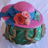 Kentucky Derby Hat Cake  Kentucky Derby themed Bridal Shower cake with chevron detail bottom, and gold dusted peanut butter horseshoes. Top tier is carved into a...