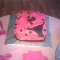 Lingerie Shower Cake White cake dyed pink with a pink lacy bra and black panties with pink lace made from fondant. Butter cream icing with fondant polka dots.