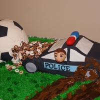 "Police Car Crashes Into Donut Filled Soccer Ball Grooms cake made for a soccer loving police officer. The police car is definitely lacking in the ""dimensions"" department, but the..."