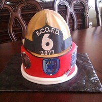 Firefighter Grooms Cake Firefighter helmet is chocolate cake, covered in fondant, with fondant/gumpaste accents. Base is also chocolate cake, covered in fonddant,...