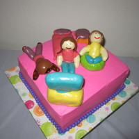 "Slumber Party Cake  10"" square chocolate cake with vanilla butter cream. All figurines are made with rice krispie treats covered with different flavor..."