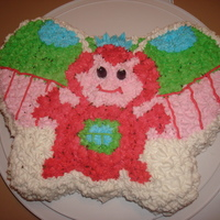 Webkinz Zumbuddy Birthday Cake My 13-year-old made this for her 4-year-old sister. She used the Wilton Butterfly pan and free-handed the design with a star-tip.
