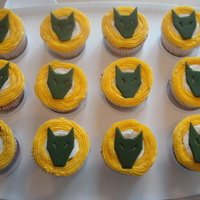 Cub Cakes!  lemon cupcakes with lemon & coconut buttercream and strawberry jam filling. These were decorated with the Cub Scout symbol for my son&#...