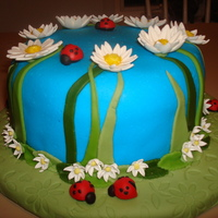 Wilton Fondant Course -- Final Cake -- Daisy And Ladybug Garden. This was my final cake and I am pleased with the result. I had a little trouble with my blue MMF being a little dry. Cake and crumb coat...