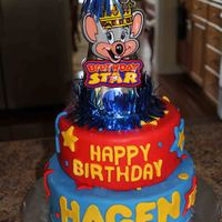 Chuck E Cheese Cake   Marble cake covered in MMF with all MMF decorations