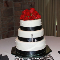 Wedding Cake   White cake covered in MMF with black ribbon and edible sugar beads