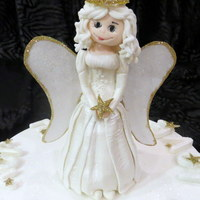 Christmas Cake With Edible Angel Made From Modelling Paste This cake was made for a school raffle for deaf pupils.The angel is made from modelling paste, with rice paper wings. The cake is a rich...