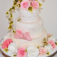 Wedding Cake With Lots Of Sugar Roses And Ivy