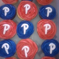 Phillie T-Ball Team Cupcakes Cupcakes for my sons t-ball team. The red are vanilla and blue...chocolate. The frosting is buttercream mixed with white chocolate ganache...