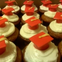 Graduation Cupcakes   VANILLA ALMOND CUPCAKES WITH BUTTERCREAM FROSTING AND FONDANT GRADUATION CAPS