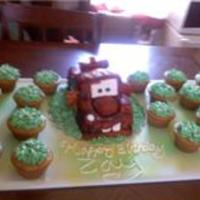 Mater Cake  This cake was made for a 2 year old. He was very happy this was my second fondant cake. I went ahead and added cupcakes frosted with...