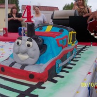 Thomas The Trainengine  My son loves Thomas The Train Engine. The cake was white with cajeta and pecan filling with marshmallow fondant. My son loved the cake and...