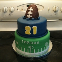 Football Fan This cake is covered in MMF, the football is rice crispie treats covered in chocolate fondant.