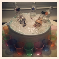 "Drink Up! The cake is covered in MMF and spray painted silver to look like a bucket. The ""ice"" is made out of isomalt and corn syrup. The..."
