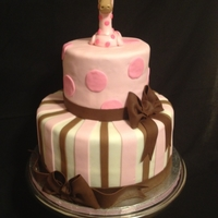 Baby Shower I loved making this cake the only requirement given by the customer was that the cake have a giraffe on top and to have brown and pink....