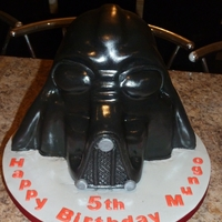 Darth Vader Helmet Maderia sponge covered on Black fondant... Massive thatnks to Baking Girl for emailing me the instructions... 4 Years after she originally...