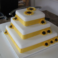 Sunflower Wedding Cake Fruit cake (bottom tier and madiera sponge top 2 tiers. Covered in fondant. My first attempt at a tiered cake and flowers!